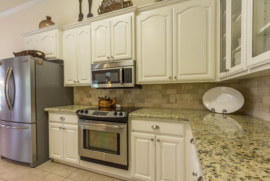 antique white kitchen cabinets with stainless steel ...