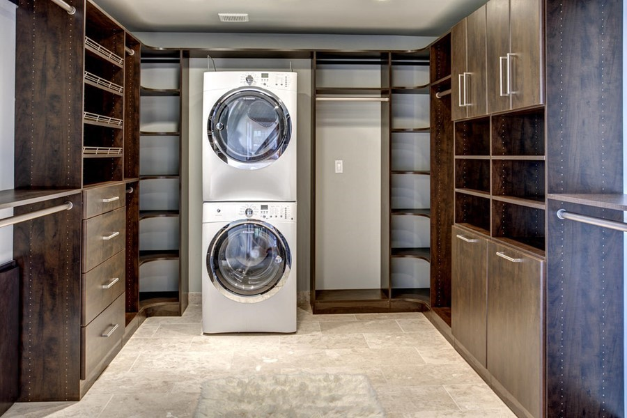 master bedroom closet with washer and dryer 3